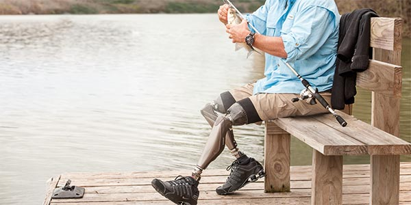 Man fishing with a prosthetic leg